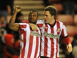 Stephane Sessegnon and Craig Gardner