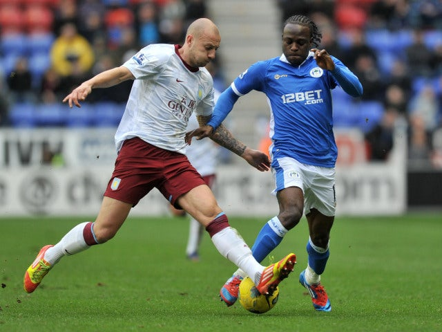 Alan Hutton and Victor Moses