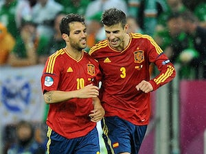 Pique: 'Fabregas is happy at Barcelona'