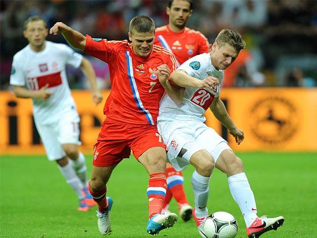 Lukasz Piszczek, Igor Denisov