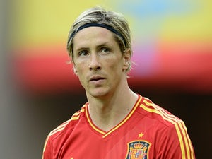 Torres delighted with 100th cap