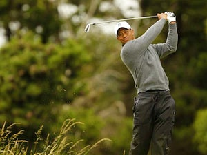 Woods delighted after 'tough' second round