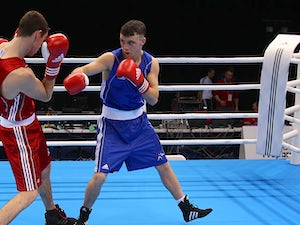 Result: Team GB's Evans to fight for gold