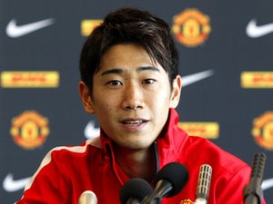 Rooney excited to be alongside Kagawa