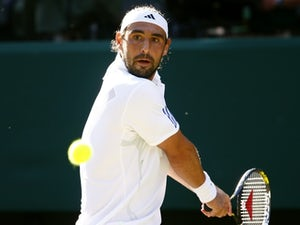 Result: Baghdatis fights off Raonic in second round