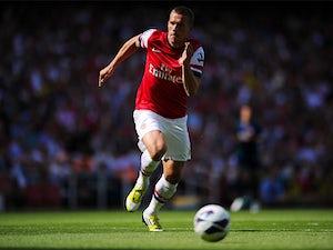 Podolski confident of qualification