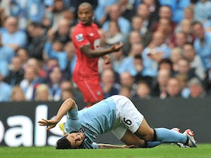 Aguero plays down injury fears