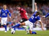 Wayne Rooney and Phil Jagielka