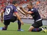 Lukas Podolski, Santi Cazorla