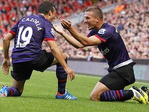 Podolski eyes title challenge