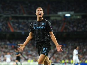 Dzeko dismisses exit claims