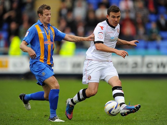Walsall's Andy Butler and Shrewsbury's Paul Parry