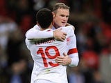 Wayne Rooney and Aaron Lennon celebrate