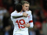 Wayne Rooney and Aaron Lennon celebrate