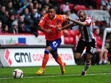 Oldham Athletic's Reece Wabara and Sheffield United's Marcus Williams