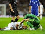 Theo Walcott lies injured