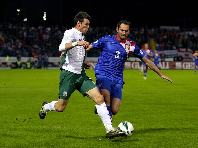 Josip Simunic of Croatia and Gareth Bale of Wales