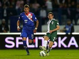 Mario Mandzukic of Croatia and Joe Allen of Wales