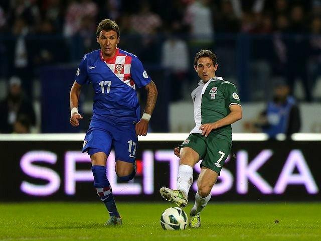 Mario Mandzukic of Croatia and Joe Allen of Wales