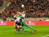 Allan McGregor makes a save for Scotland