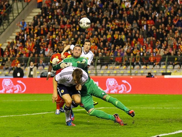 Allan McGregor makes a save for Scotland