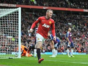 Rooney dresses son Kai as The Joker