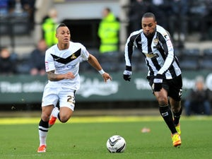 Notts County's Yoann Arquin and Doncaster Rovers' Kyle Bennett