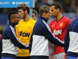 Ashley Cole and Rio Ferdinand shake hands before the game