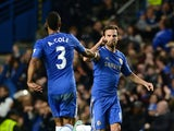 Juan Mata celebrates scoring with Ashley Cole