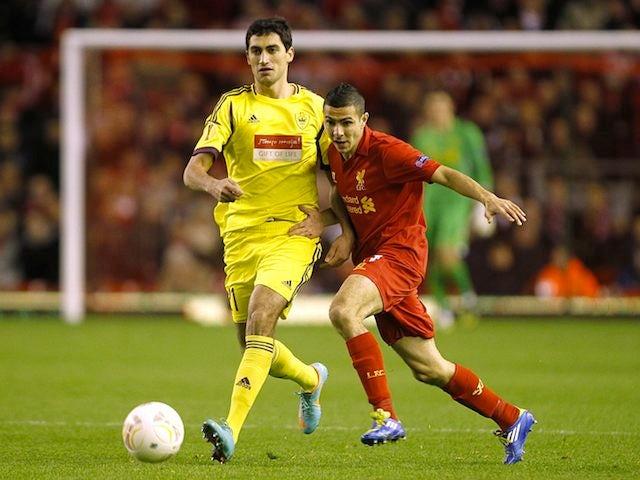 Anzhi Makhachkala's Georgi Gabulov and Liverpool's Oussama Assaidi on October 25