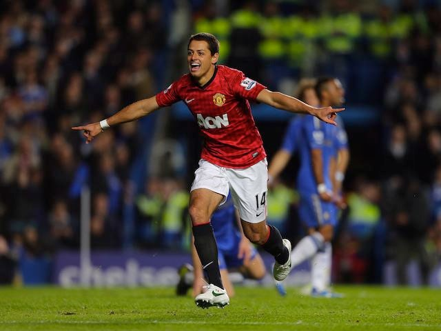 Javier Hernandez celebrates scoring United's third