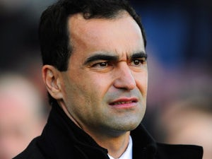 Whelan backs Martinez for top job