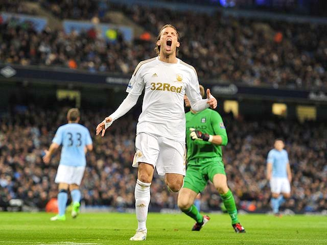 Michu reacts after a chance missed