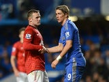 Wayne Rooney helps Fernando Torres to his feet