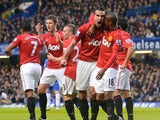 Robin van Persie celebrates scoring for United