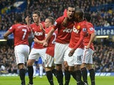 Robin van Persie celebrates scoring for United