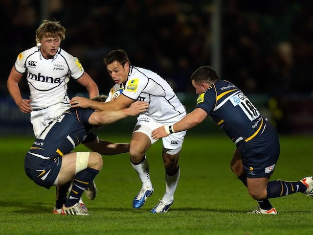 Sale's Rob Miller is tackled by Worcester's Matt Kvesic and Ed Shervington