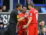 Steven Gerrard mediates as Raheem Sterling is told off by the ref