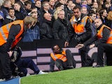 A steward falls over trying to control the fans