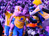 Michael Turner celebrates equalising for Norwich