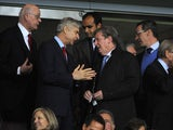Arsene Wenger having a laugh in the stands with Roy Hodgson