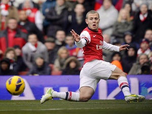 Wilshere urges Walcott to stay