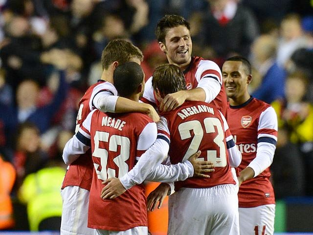 Arsenal players celebrate their 7-5 victory over Reading