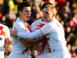 Sam Tomkins congratulates Tom Briscoe on scoring a try for England