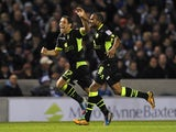 Michael Brown celebrates with Rodolph Austin after scoring Leeds's second