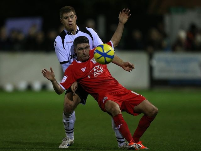 Cambridge City's Lee Chaffey and Milton Keynes Dons' Ryan Lowe