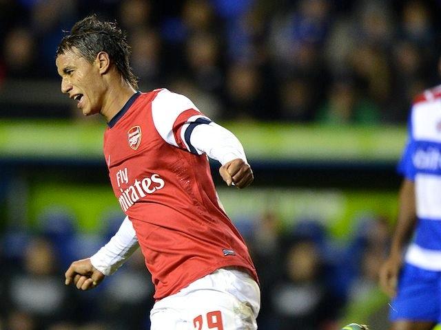 Marouane Chamakh celebrates scoring Arsenal's fifth