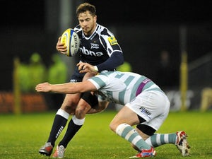 Sale Sharks' Danny Cipriani is tackled by London Irish's Scott Lawson