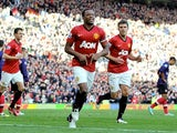 Patrice Evra celebrates scoring United's second