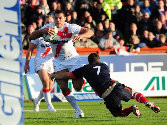 France's William Barthau tackles England's Ryan Hall